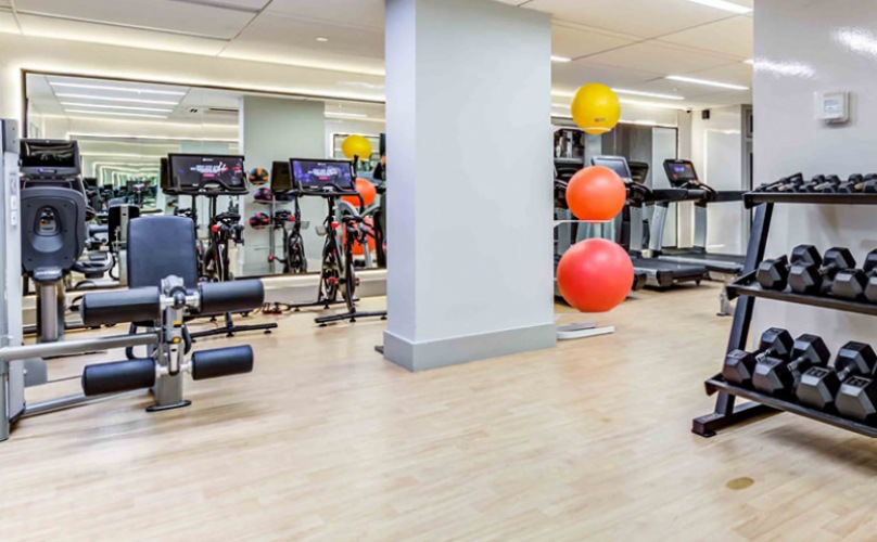 fitness center with central ac and fluorescent lighting